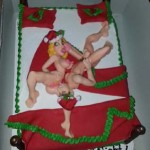 Christmas-sexy-man-and-girl-doll-on-holiday-bed-cake