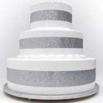 silver pop out four feet high four feet round cake